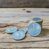 Assorted of coins on old Rough Brown Wood. Royalty Free Stock Image