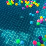 Assorted-color Balls Floating on Water stock image