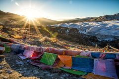 Assorted-color Flags on Mountain during Sunrise stock image