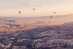 Assorted Color Hot Air Balloons Flying over Mountain Ranges during Day Stock Photo