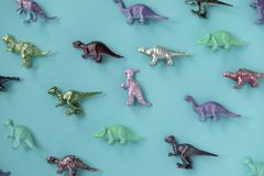 Assorted-color Plastic Dinosaur Figurine Lot on Teal Surface royalty free stock photography