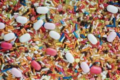 Assorted-color Sprinkles With White and Pink Candy Capsules royalty free stock photos