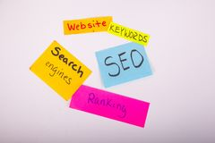 SEO search engine ranking website keywords on sticky notes. Assorted color sticky notes website search engine SEO ranking keyword written words Royalty Free Stock Image