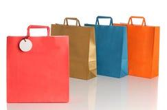 Assorted coloreó bolsos de compras sobre blanco Foto de archivo libre de regalías