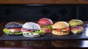 Assorted coloreó las hamburguesas Fotografía de archivo libre de regalías