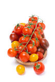 Assorted colored cherry tomatoes in wooden bowl, isolated Royalty Free Stock Photo