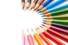 Assorted colored crayon creative arrangement with copy space. Assorted colored crayon creative arrangement on white with copy space Stock Images