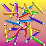 Assorted Colored Pencils on Pink & Yellow gradient. Arrangement of colored pencils with a pink & yellow gradient background Royalty Free Stock Image