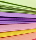 Assorted Colored Pile of Papers. Background royalty free stock image