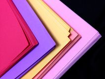 Assorted Colored Pile of Papers. On Black Background stock photos