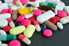 Assorted colored pills Stock Images