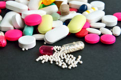 Assorted colored pills Stock Photography