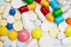 Assorted colored pills and capsules Royalty Free Stock Images