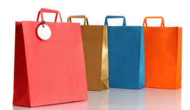 Assorted colored shopping bags over white Stock Photos