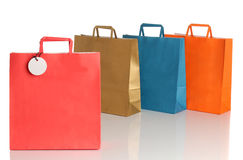 Assorted colored shopping bags over white Royalty Free Stock Photo