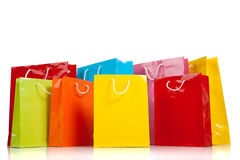 Assorted colored shopping bags on white Royalty Free Stock Photo