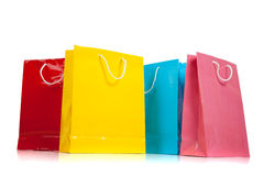 Assorted colored shopping bags on white Royalty Free Stock Photography
