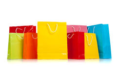 Assorted colored shopping bags on white Stock Photos