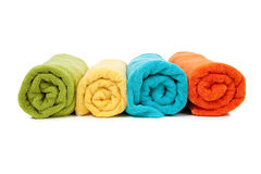 Assorted colored towels on white Royalty Free Stock Image