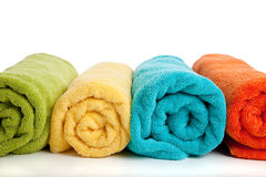 Assorted colored towels on white Royalty Free Stock Photography