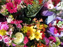 Assorted colorful bright flower bouquets on display. At the flower shop stock image