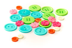 Assorted colorful buttons over white Stock Photography