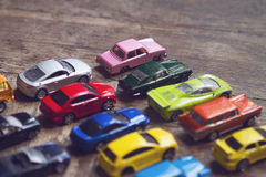 Assorted colorful car collection on floor Royalty Free Stock Images