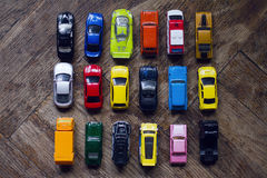 Assorted colorful car collection on floor Stock Images
