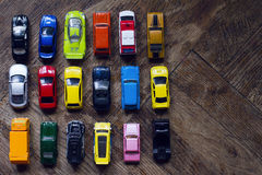 Assorted colorful car collection on floor Stock Photos