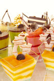 Assorted colorful desserts. An assortment of colorful mousse desserts in cups Royalty Free Stock Images