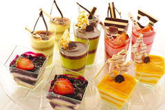 Assorted colorful desserts. An assortment of colorful mousse desserts in cups Royalty Free Stock Photo