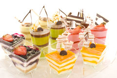 Assorted colorful desserts. An assortment of colorful mousse desserts in cups Stock Images