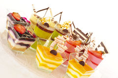 Assorted colorful desserts. An assortment of colorful mousse desserts in cups Stock Photo
