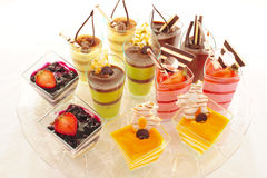 Assorted colorful desserts. An assortment of colorful mousse desserts in cups Stock Image