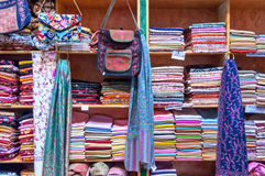Assorted colorful fabrics on display in a shop Muttrah Souk, in Mutrah, Muscat, Oman, Middle East Stock Images