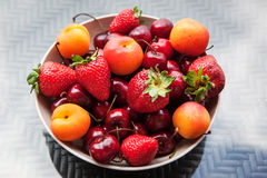 Assorted colorful fresh summer berries and fruits Stock Image