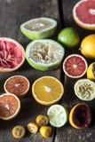 Assorted colorful halved citrus fruits. With oranges, blood orange, grapefruit, lime and lemon, some of which have been squeezed to extract the juice on a Royalty Free Stock Images