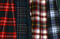 Assorted colorful hanging tartan kilts. Many patterns, colors, and designs designate different clans, and kilt uses such as hunting royalty free stock photography