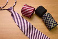 Assorted colorful Necktie. On Wood Background Royalty Free Stock Photography
