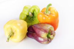 Assorted colorful peppers on white Royalty Free Stock Photography