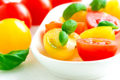 Assorted colorful red and yellow cherry tomatoes in plate on tab Royalty Free Stock Photos