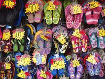 Assorted colorful rubber slippers on sale at a store Stock Photo
