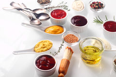 Assorted Condiments on White Wooden Table Stock Photos