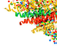 Assorted confetti with shiny colorful streamer on white. Background. party decoration Royalty Free Stock Photos
