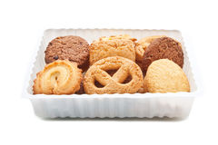 Assorted cookie in plastic box ,  on white. Studio shot Stock Photos