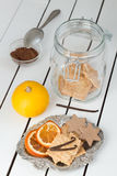 Assorted Cookies and Citrus Fruit Chips. White Wooden Table Background Stock Photo