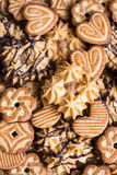 Assorted cookies with cocoa, dark and white chocolate glaze and nuts Stock Photos