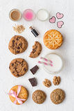 Assorted Cookies and Milk. On a White Background Royalty Free Stock Images