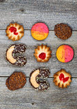 Assorted cookies organized on rustic wood Stock Photography