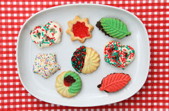 Assorted cookies on a plate. On a red and white checkered background Royalty Free Stock Image